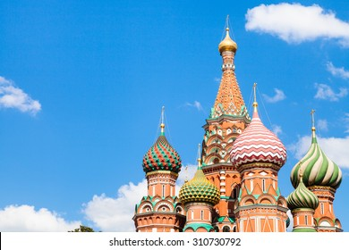 Vasily the Blessed cathedral on Red Square in Moscow and blue sky with white clouds in sunny summer day