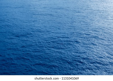 Vast blue ocean background with moderate waves