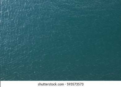 Vast blue ocean background with moderate waves looking straight down