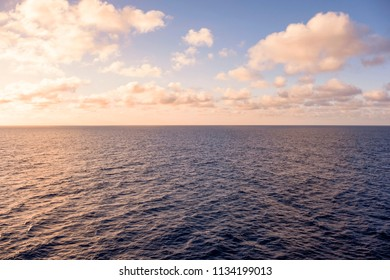 Vast blue ocean with moderate waves on during twilight