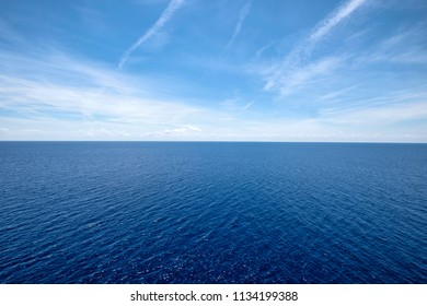 Vast blue ocean with moderate waves on a sunny day