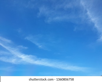 The vast blue sky, bright colors, partial clouds