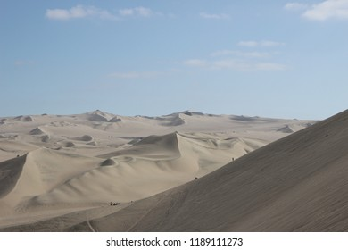 Vast desert landscape - Huacachina, Peru - sand and blue sky, dunes, steps on sand