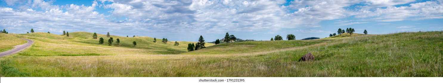 Vast empty grassland with rolling hills depicting peace