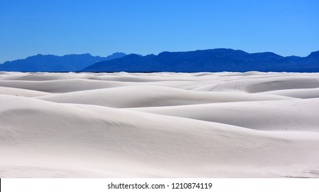 the vast expanses and mountain peaks of  white sands national monument on a sunny day, near alamogordo, new mexico