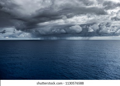 Vast ocean with an incoming storm front