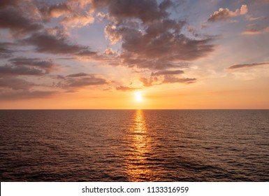 Vast ocean with moderate waves during sunset
