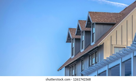 Vast sky with contrail and home in Daybreak Utah