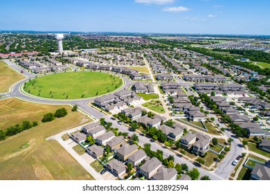Vast Texas hill country living , Pflugerville Texas USA aerial drone view above houses and homes modern suburb new development huge circle architecture design
