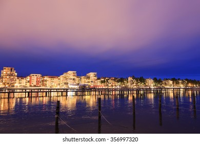 Vasteras skyline in sunset with lake Malaren in the front.