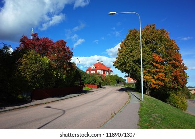 Vasteras, Sweden - 23 September, 2018: Typical calm town street in Vasteras with traditional swedish house and trees, Idyllic nordic neighborhood on Sankta Ursulas vag