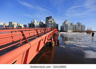 Vasteras, Sweden - February 15: People walking over the bridge to the fashionable part of Vasteras in a cold sunny winter day on February 15, 2015 in Vasteras.