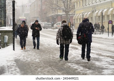 Vasteras, Sweden - January 12: People struggling to move forward in the snowstorm on January 12, 2015 in Vasteras, Sweden.