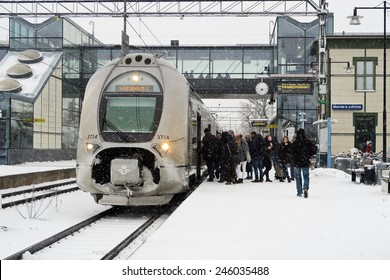Vasteras, Sweden - January 21: Passenger board a train to capital Stockholm on a snowy winter day in the city of Vasteras on January 21, 2015 in Vasteras, Sweden.