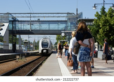 Vasteras, Sweden - July 14: Passenger waiting for the train on the railroad station platform on October July 14, 2014 in Vasteras.