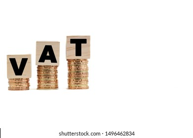 VAT Concept with colorful wooden block and stacked coins on white background