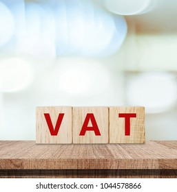 Vat on wooden cubes over blur background with copy spcae, financial concept background