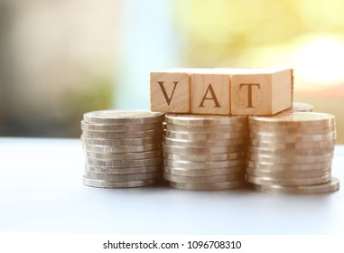 Vat word wooden Blocks and money coin stack