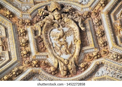 Vatican, 10/22/2015 Illustrative Editorial Gilded stucco on the ceiling in the portico of the main Catholic cathedral, biblical scenes. Close-up, high contrast.