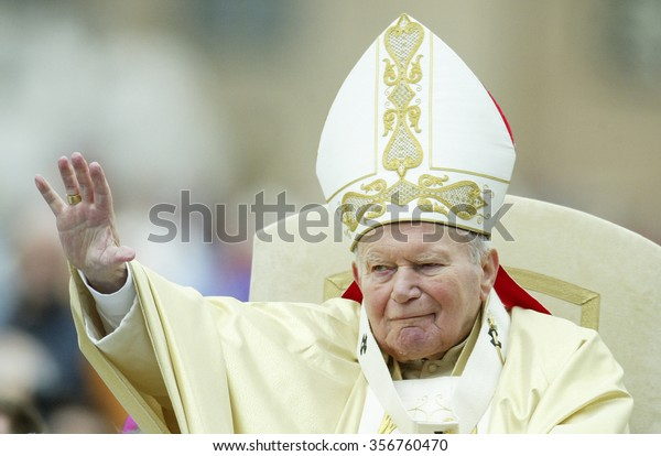 VATICAN CITY, VATICAN - 25 APRIL 2004: Pope John Paul II blesses the pilgrims during the weekly general audience in Saint Peter's Square at the Vatican.