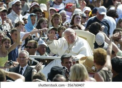 VATICAN CITY, VATICAN - 30 JUNE 2004: Pope John Paul II blesses the pilgrims during the weekly general audience in Saint Peter's Square at the Vatican.