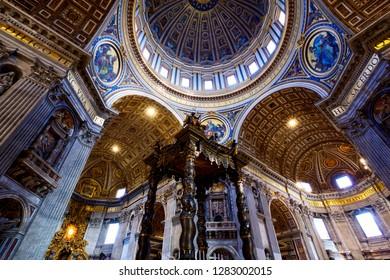 VATICAN CITY, VATICAN - APRIL 16, 2018: Luxury interior of St Peter's Basilica the main catholic landmark