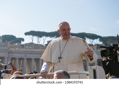 Vatican City - April 17, 2019: His Holiness Pope Francis I greets gathered prayers as he arrives for  audience in St Peter's square at the Vatican.