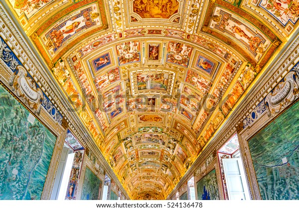 VATICAN, VATICAN CITY - APRIL 4, 2016: Paintings on the walls and the ceiling in the Gallery of Maps, at the Vatican Museum. It was established in 1506