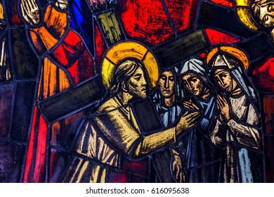 """VATICAN CITY, VATICAN - CIRCA APRIL 2017 - The eighth station of the cross: """"Jesus meets the women of Jerusalem"""". A detail of a stained glass window in the chapel of the Swiss guards in Vatican."""