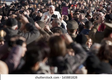 VATICAN CITY, VATICAN - DECEMBER 04 :  Pope Francis greets the pilgrims during his weekly general audience in St Peter's square at the Vatican on December 04, 2013.