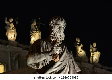 VATICAN CITY, VATICAN - DECEMBER 17, 2013: Christian religion. Saint Peter patron of the city of Rome and fist Pope of Catholic Church holding the Keys of Heaven, with blessing Jesus and apostles