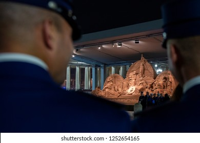 Vatican City, December 7, 2018: Two Vatican Gendarmi look at the Jelso Nativity scene that was unveiled in St. Peter's Square at the Vatican, during the inauguration.
