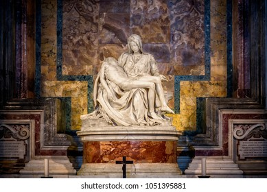 Vatican City, Vatican - February 13, 2018 : The Piety of the Vatican or Pieta is a sculptural group in marble by Michelangelo in the interior of Papal basilica of Saint Peter in Vatican City