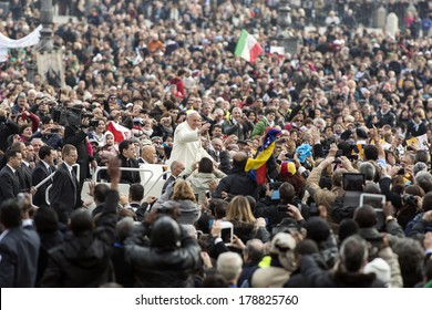 VATICAN CITY, VATICAN - February 26, 2014 :  Pope Francis greets the pilgrims during his weekly general audience in St Peter's square at the Vatican on February 26, 2014.