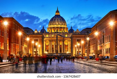Vatican City Holy( See). Dome of St. Peters Basil cathedral at Saint Peters Square. Evening sunset, blue hour with night sky and street lamps. Rome, Italy.