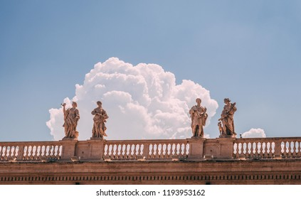 Vatican City, Italy - August 2018: Apostles Stone sculptures on the roof of Saint Peter Basilica in Vatican, Rome.