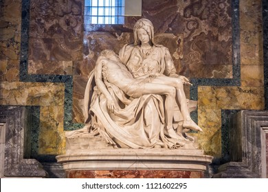 Vatican City, Italy - June 2018 - The Piety of the Vatican or Pieta is a sculptural group in marble by Michelangelo in the interior of Papal basilica of Saint Peter in Vatican City