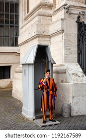 Vatican City, Italy, May 8, 2013: Member of the Swiss Guards on duty inside the Vatican. The Swiss Guard act as personal escorts to the pontiff and as watchmen for the Vatican City