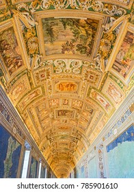 VATICAN CITY, ITALY:  OCTOBER 11, 2017:  Paintings on the walls and ceilings in the Gallery of Maps hall in the Vatican Museum