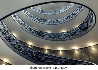Vatican City, Vatican - July 12, 2018: Bramante Staircase in Vatican Museums in Vatican. Famous staircase designed by Giuseppe Momo viewed from the bottom.