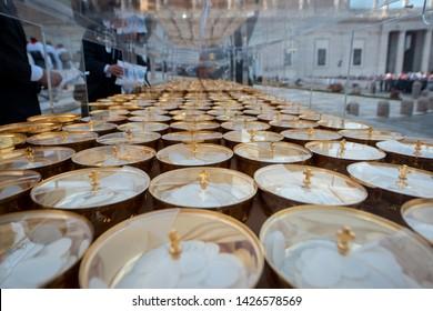 Vatican city, June 08, 2019: Priests preparing ciborium of the holy communion before Pope Francis Pentecost mass-vigil in Saint Peter's square at the Vatican.
