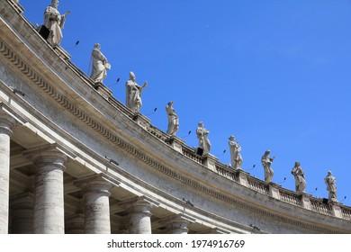 Vatican City landmark. Saint statues in the colonnade of  Saint Peter's Square (Piazza San Pietro) of Vatican. - Shutterstock ID 1974916769