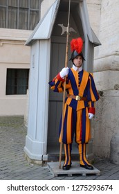 Vatican City, Vatican - March 20th, 2014: This photo captures a Pontifical Swiss Guard wearing his typical military colored uniform.