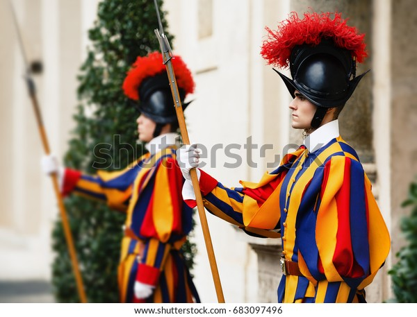 VATICAN CITY, VATICAN - Nov 20, 2015: Papal Swiss Guard in uniform. Currently, the name Swiss Guard generally refers to the Pontifical Swiss Guard of the Holy See stationed at the Vatican in Rome