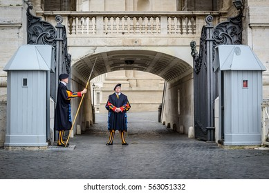 VATICAN CITY, VATICAN - NOVEMBER 14: A pair of Papal Swiss guards stand guard at the entrance of Saint Peter's Basilica on Nov 14, 2015 in Vatican City, Vatican.