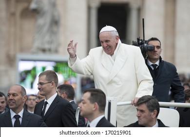 Vatican City - November 27: Pope Francis on the pope mobile bless faithful in St. Peter's Square on November 27 2013