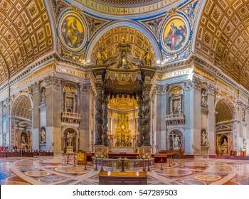 Vatican city, Vatican - October 12, 2016: Bernini's Baldacchino Altar and ornate frescoes in the Saint Peter's Basilica in Vatican City