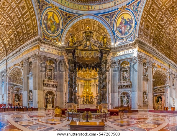 Vatican city, Vatican - October 12, 2016: Bernini's Baldacchino Altar and ornate frescoes in the Saint Peter's Basilica in Vatican City