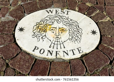 Vatican City, Rome - FEBRUARY 12, 2017:  Italy. A stone laid in St Peter's Square, Vatican City, by Bernini points in the direction of  west, Ponente.