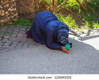 Vatican City, Rome / Italy - 10 25 2018:  Homeless beggar woman on the street begging charity. Miserable, tattered, despair person. Poor and pauper people. Starving and need help. Problem of poverty